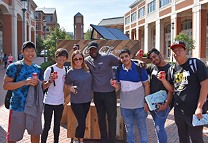 Group photo of students holding free Coke samples