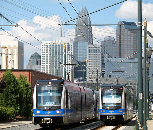 Photo of LYNX Blue Line light rail facing NE with Charlotte uptown in background
