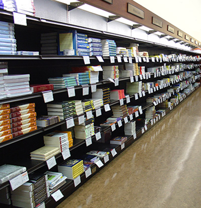 photo of textbook stacks in campus bookstore